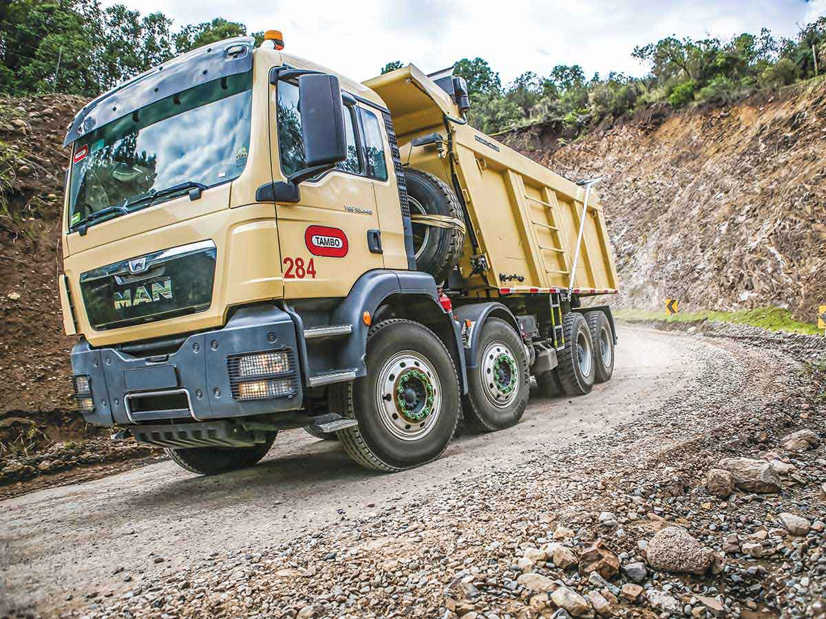 MEILLER tippers take strain on and under South American roads; carry valuable cargo through Chilean mines.