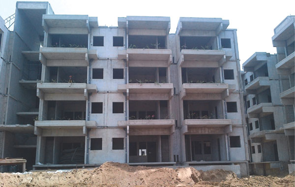 Precast technology for low cost housing schemes in india for Townhouse construction cost