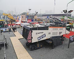 Wirtgen showcases half-meter milling machine, next-gen surface miner, mobile power feeder, new technologies